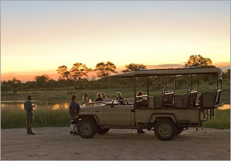 Sundowners half-way through a night game drive